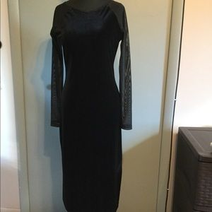 Elegant Karen Kane Dress, with sheer mesh sleeves.